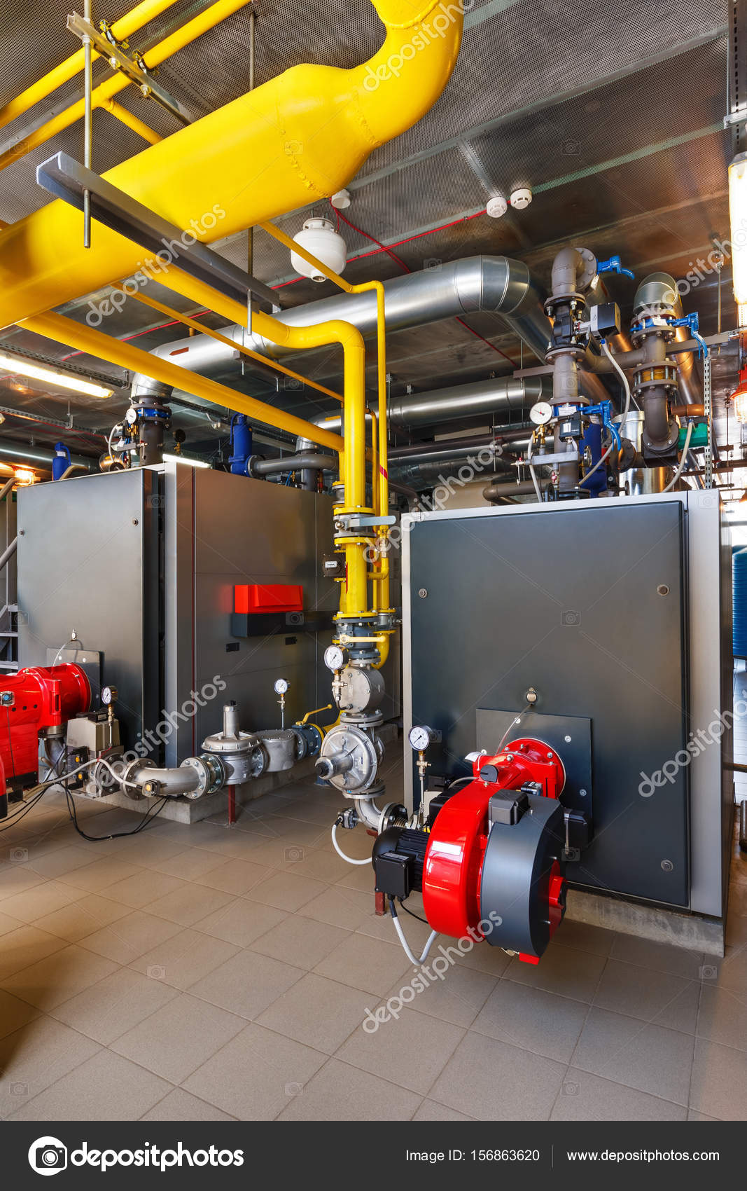 The interior of a modern gas boiler house with boilers, pumps, v ...