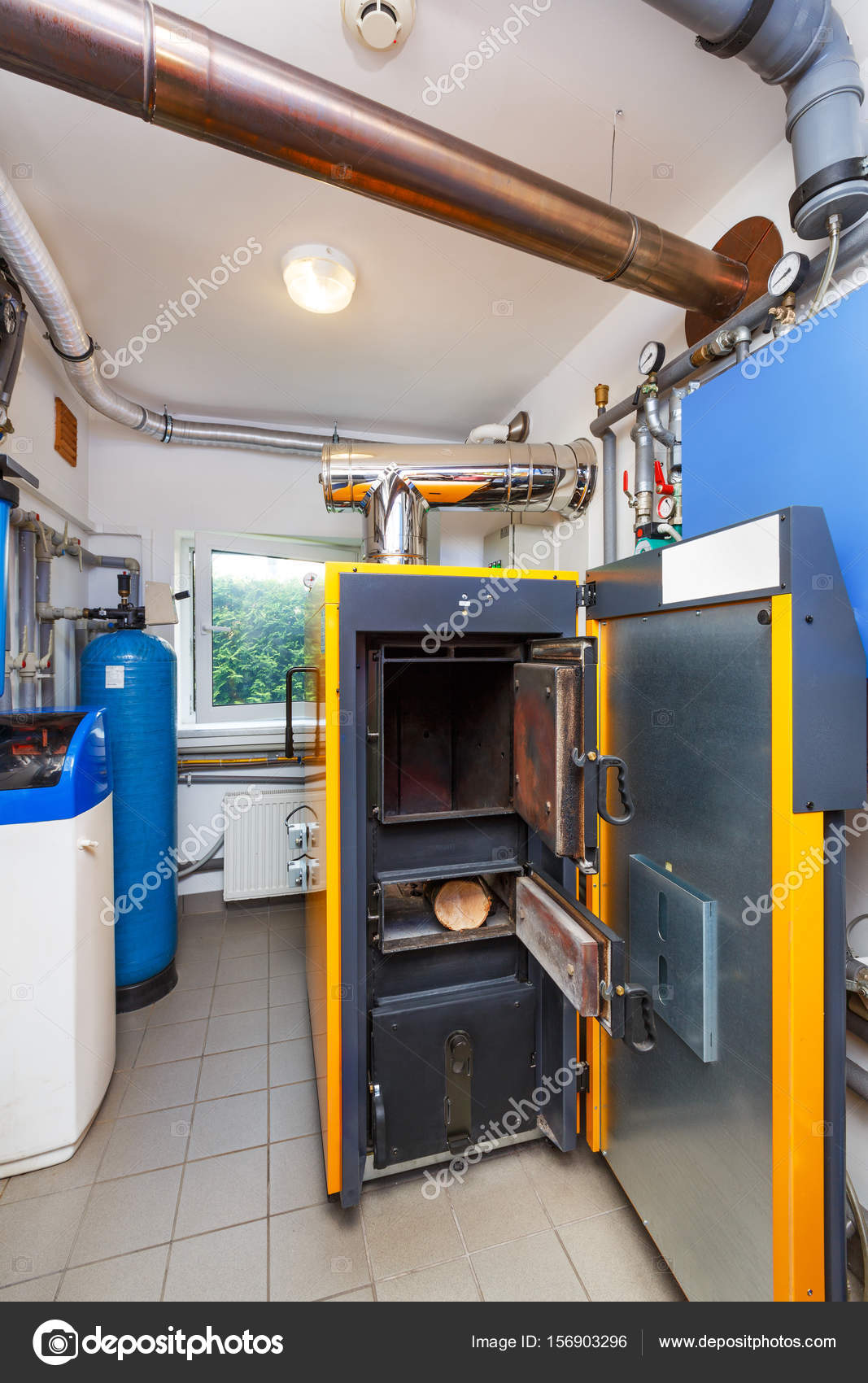 A household boiler room with a boiler on firewood, a barrel; Val ...