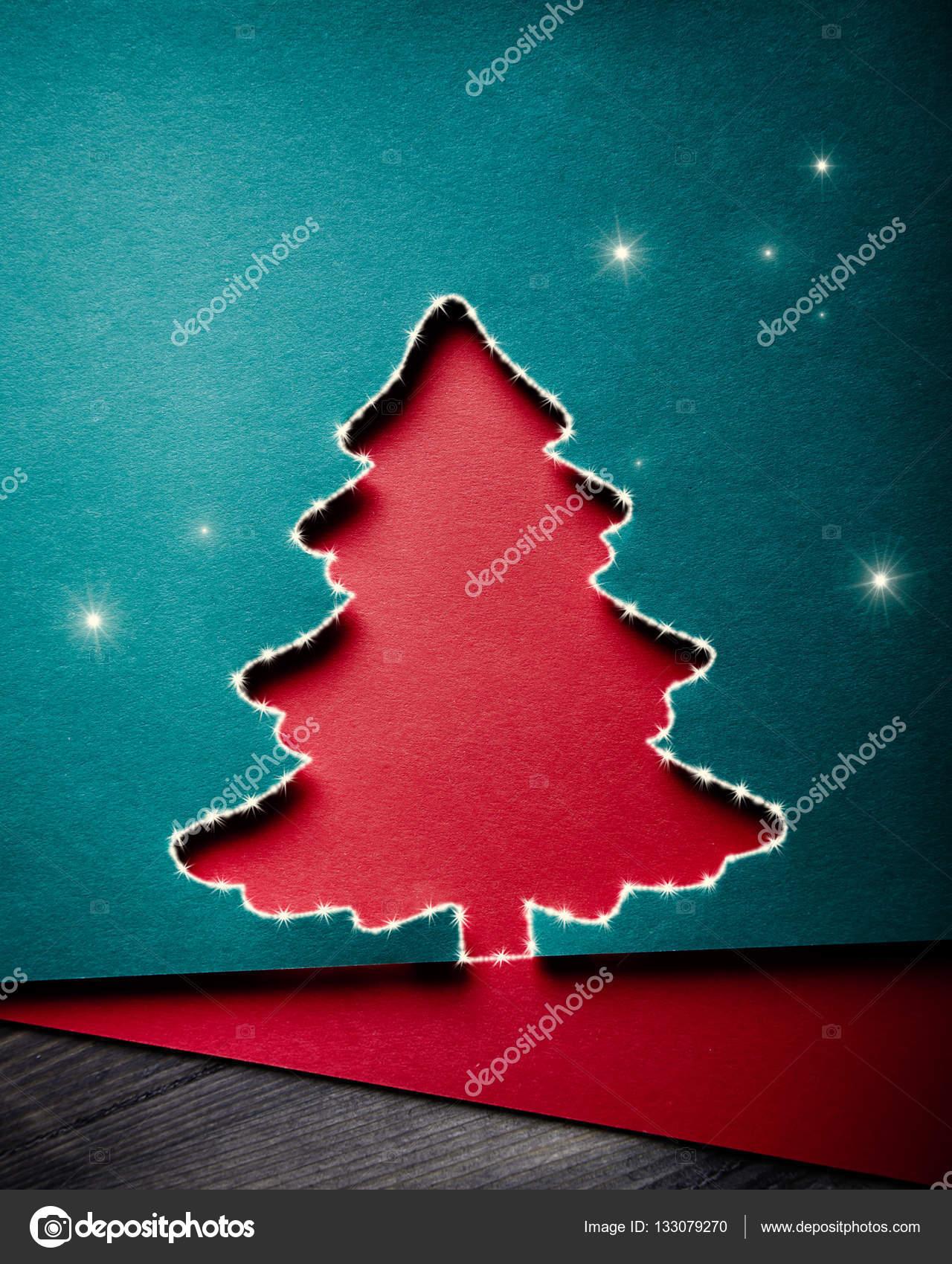 christmas greeting card with xmas tree paper cutout stock photo
