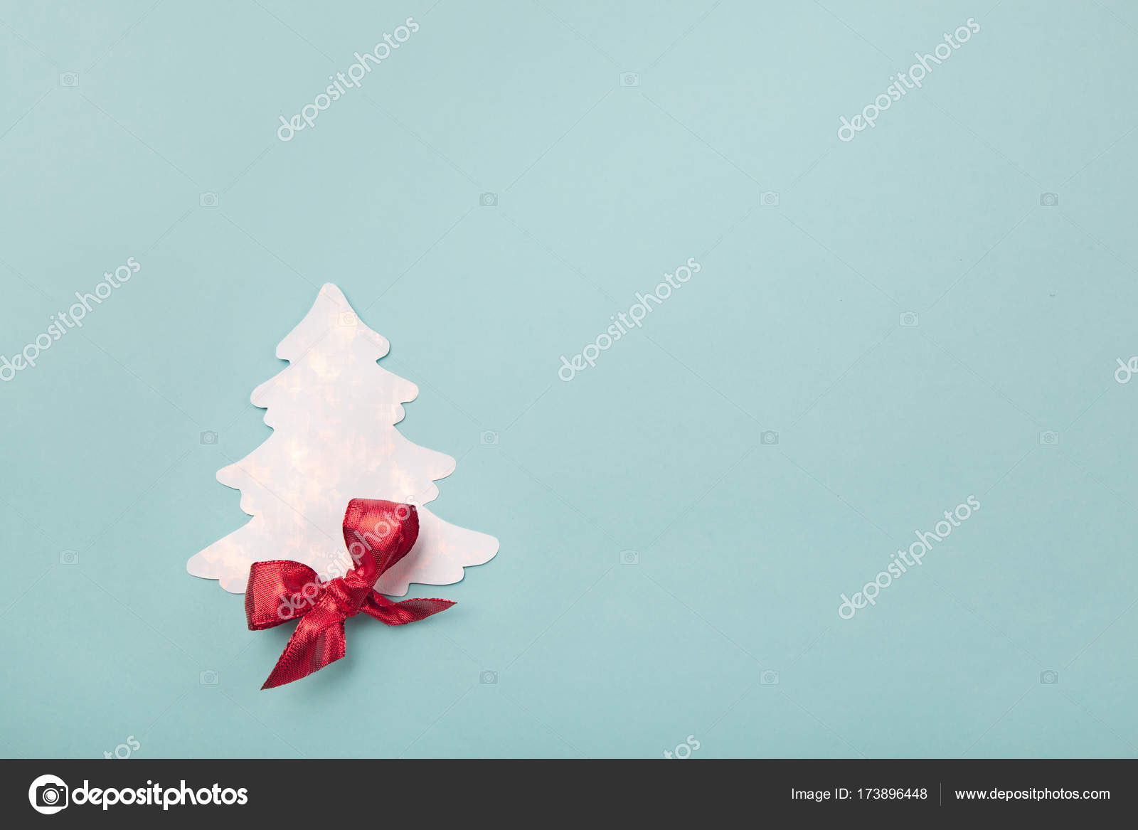 christmas greeting card with xmas tree paper cutout and red ribbon bow with digital effects added plenty of space for text