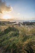 Beautiful landscape image of Freshwater West beach with sand dun