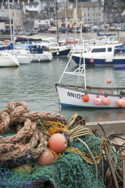 Traditional old fishing nets and boats in Lyme Regis harbour lan