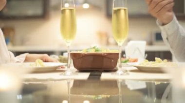 Young couple have romantic dinner with champagne.