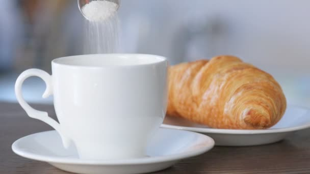 Cinemagraph - Sugar is poured from a spoon in a coffee cup. Motion Photo.
