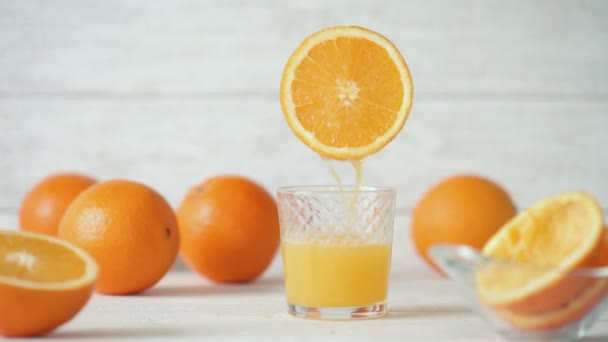 Cinemagraph - Pouring the orange juice into a glass. Nobody. Motion Photo.