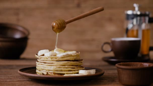 Cinemagraph - Breakfast, pouring honey on pancakes. Nobody. Living Photo.