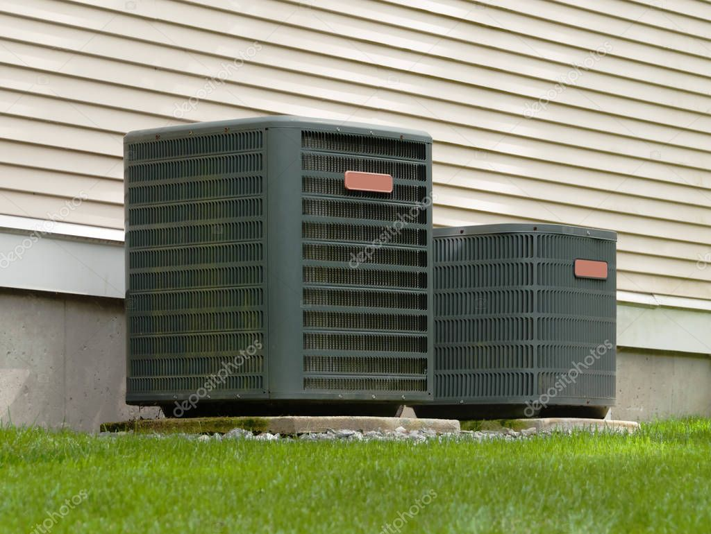Heating and air conditioning outdoor units in back of a house