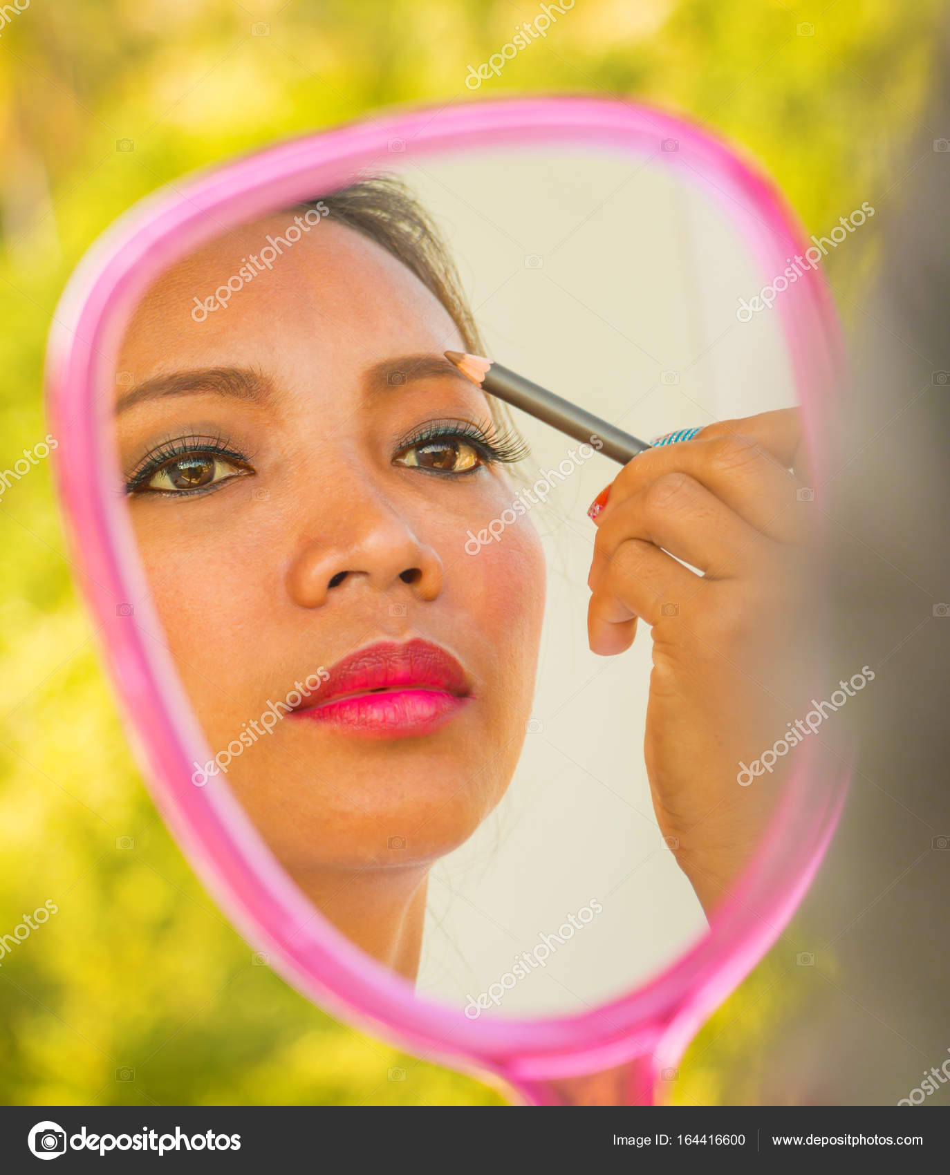 Applying Eyebrows Makeup In Mirror Shows Cosmetics Stock Photo