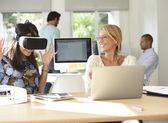 People at work testing VR headset