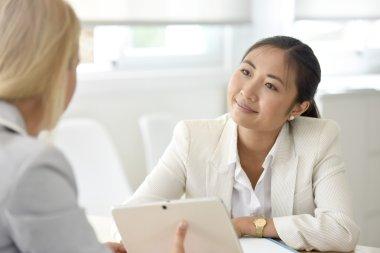 Businesswomen meeting for partnership