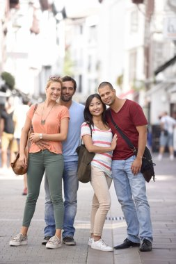 people on vacation walking on  city street