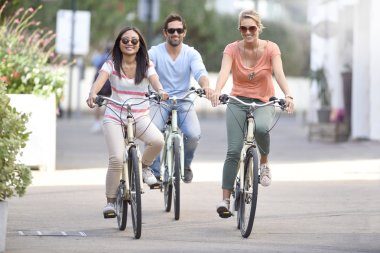 People on vacation riding bicycles