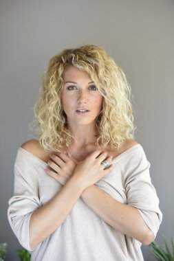 woman with long curly hair posing