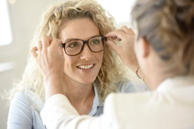 woman  trying eyeglasses on