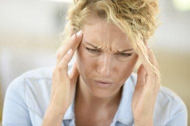 woman suffering headache