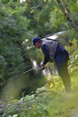Fisherman fishing  from riverbanks