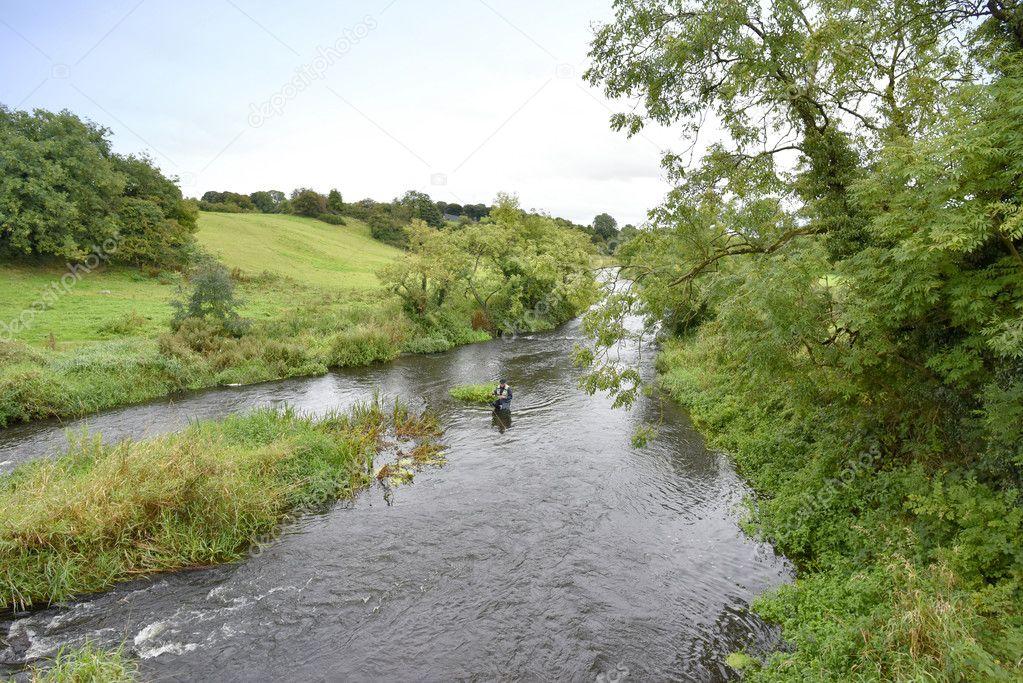 fly-fisherman fishing in river