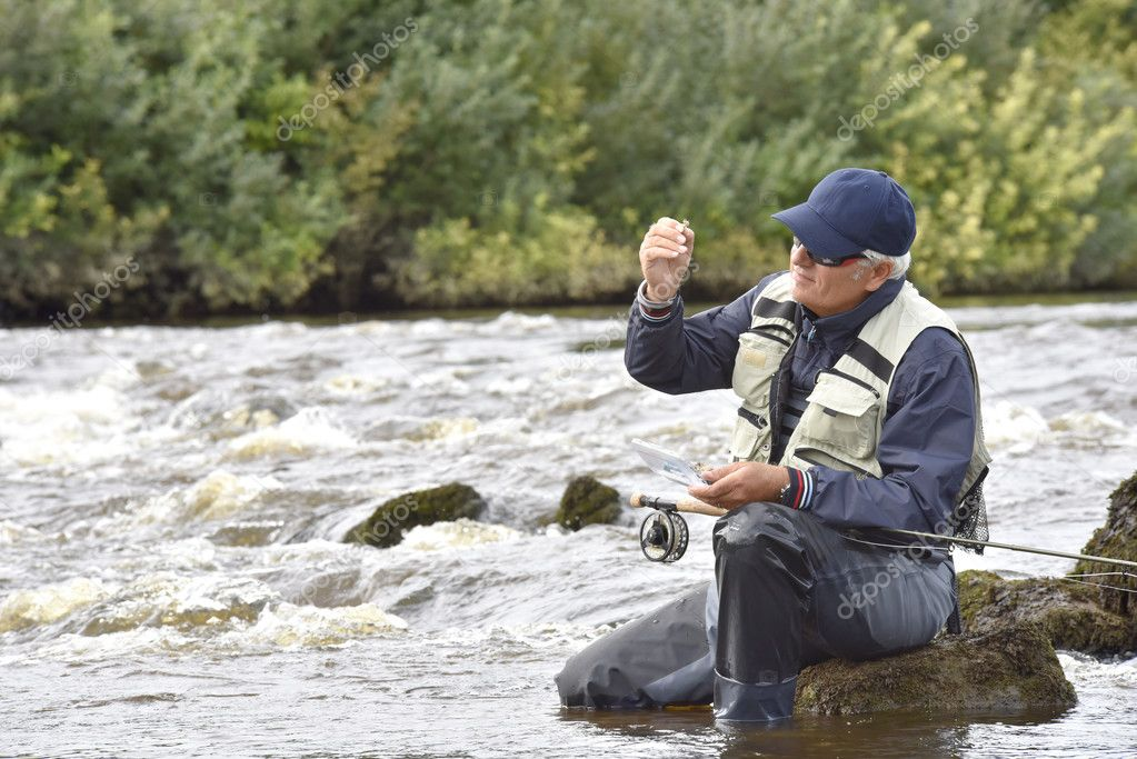 Fly-fisherman choosing fly