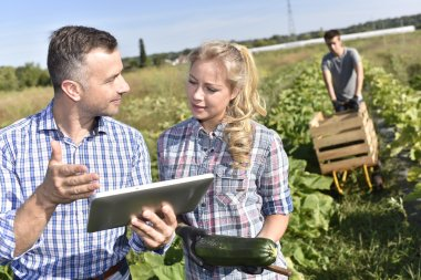 instructor with apprentice in agricultural field