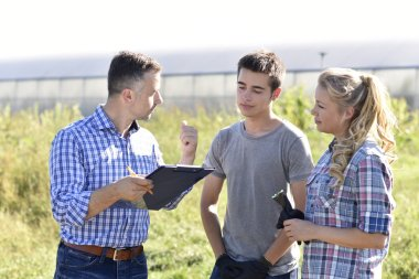 people with instructor in agricultural field
