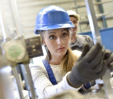 woman apprentice in metalworkshop