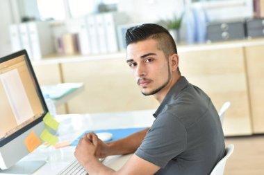 student in front of desktop computer