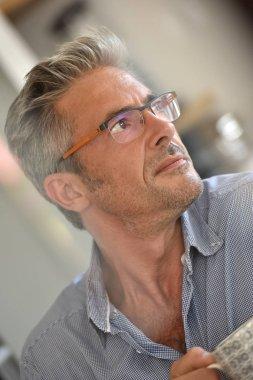 mature man with eyeglasses on