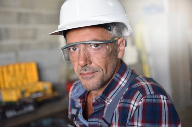 metalworker with security helmet posing