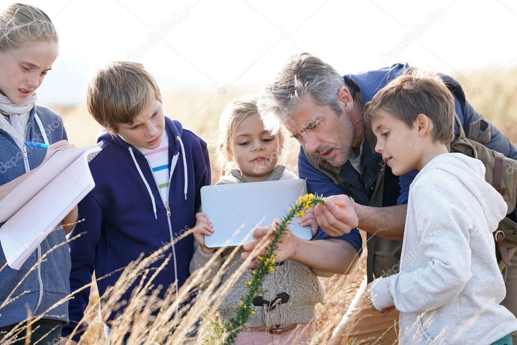 Teacher taking kids to countryside