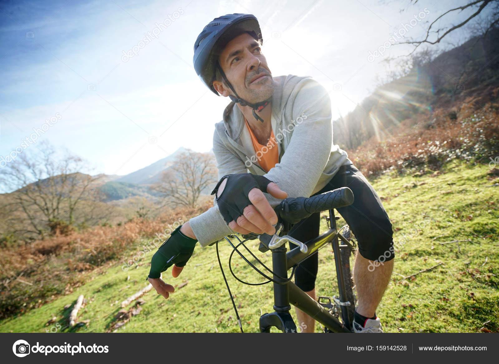 mature man riding bike — stock photo © goodluz #159142528
