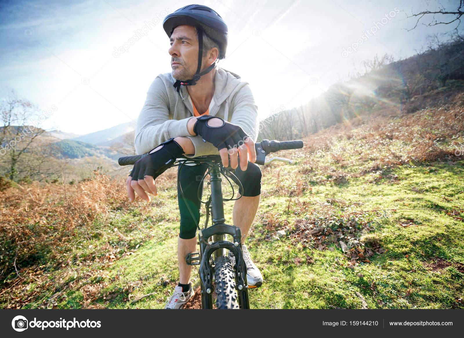 mature man riding bike — stock photo © goodluz #159144210