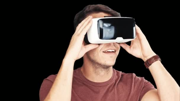 Close up shot of a young man wearing virtual reality googles / VR Glasses on black background