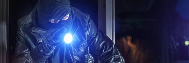 burglar breaks into house at night