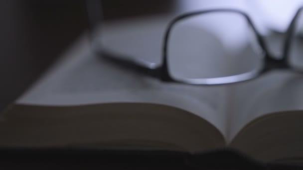 old book on desktop with modern glasses