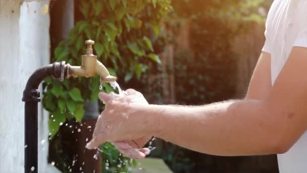 super slow motion shot of exterior tap water dripping and splash on ...