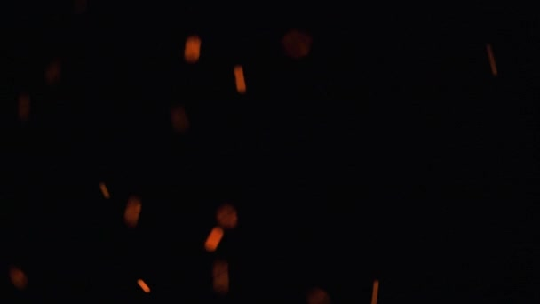 fire flames and glowing ashes on black background