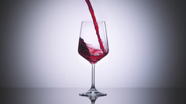 super slow motion high speed shot of red wine flowing into a big bordeaux wineglass - shot with ultra high speed camera