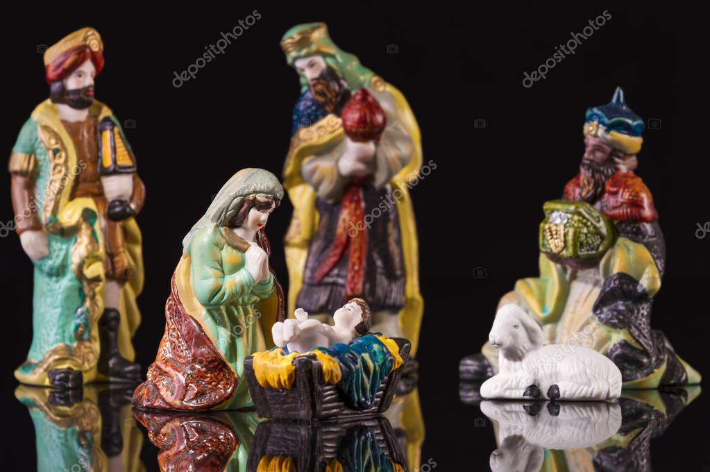 christmas manger scene with figurines including jesus mary and magi focus on mary photo by manae
