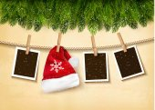 Photo Christmas tree branches with photos and a Santa hat. Vector.
