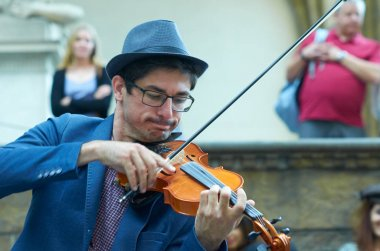 FLORENCE, ITALY, MAY 11:  Street artist playing Violin in hystor