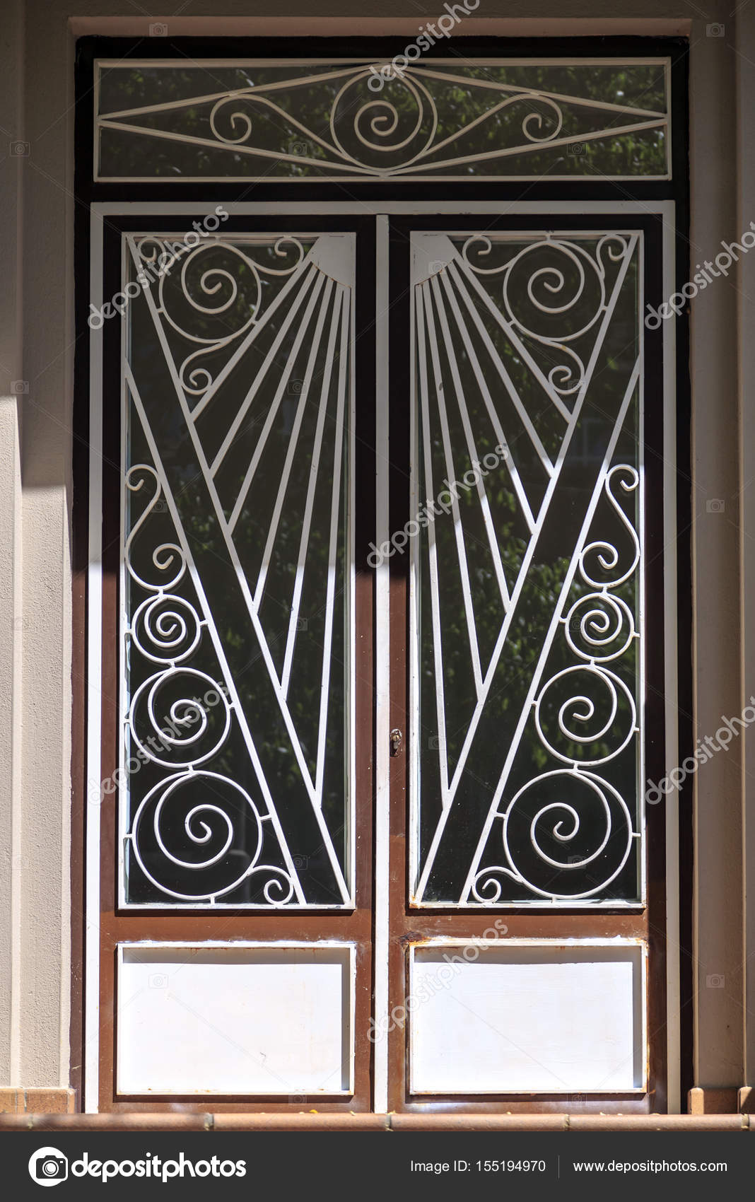 Beautiful metal ornate art deco door architectural detail \u2014 Photo by EnginKorkmaz & Metal ornate art deco door \u2014 Stock Photo © EnginKorkmaz #155194970