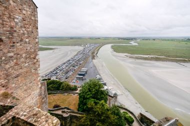 causeway to Le Mont Saint-Michel island in rain