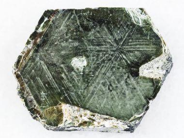 Phlogopite mica stone on white marble