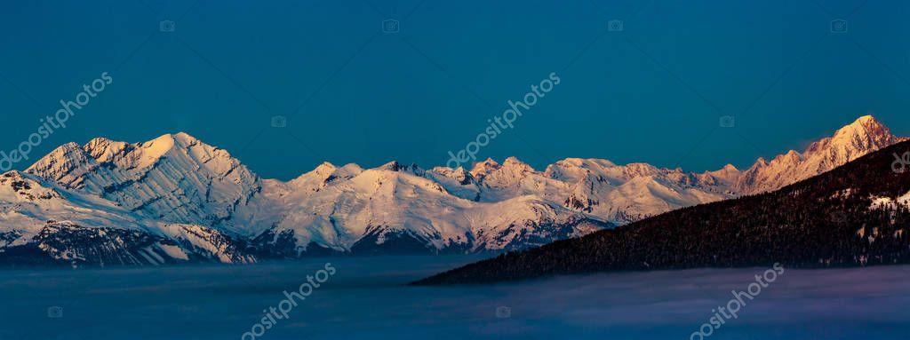 Scenic panorama sunset landscape of Crans-Montana range in Swiss