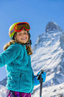 Girl on skiing on snow on a sunny day in the mountains. Ski in w