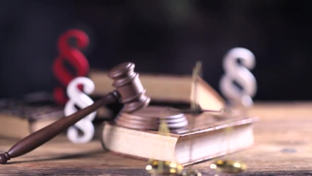 Law and justice concept. Law symbols on wooden table and bokeh background. Dolly shot.
