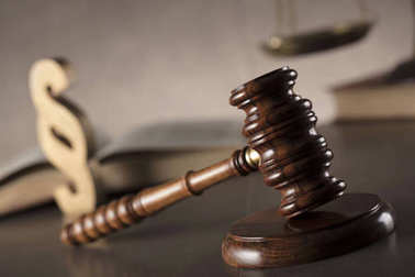 Judge antique gavel,scale, book and paragraph sign - law symbols on stone table and background.