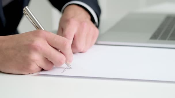 Business concept. Man signs contract in office at the table