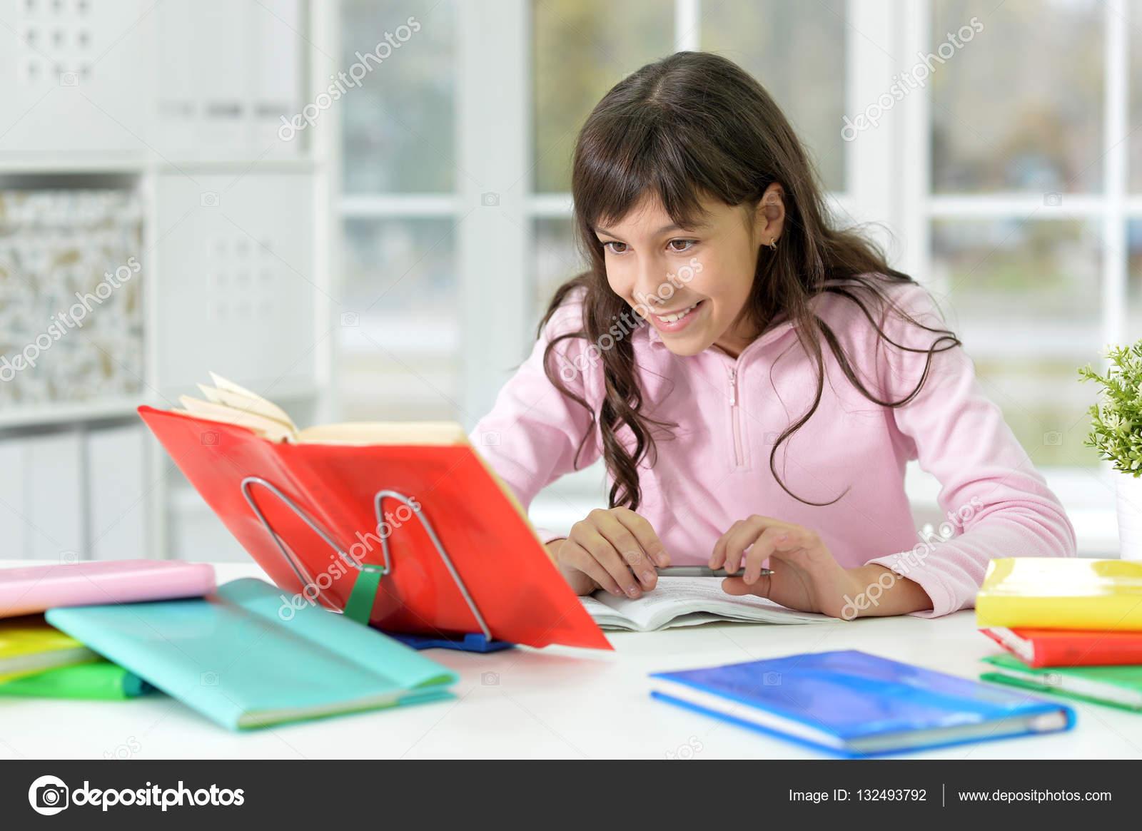 https://st3.depositphotos.com/1080148/13249/i/1600/depositphotos_132493792-stock-photo-girl-doing-homework.jpg