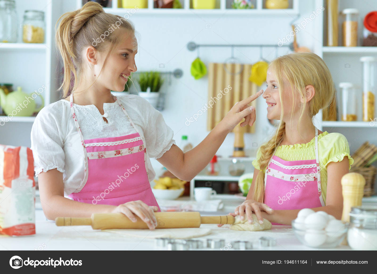 Two sisters in kitchen — Stock Photo © aletia #194611164